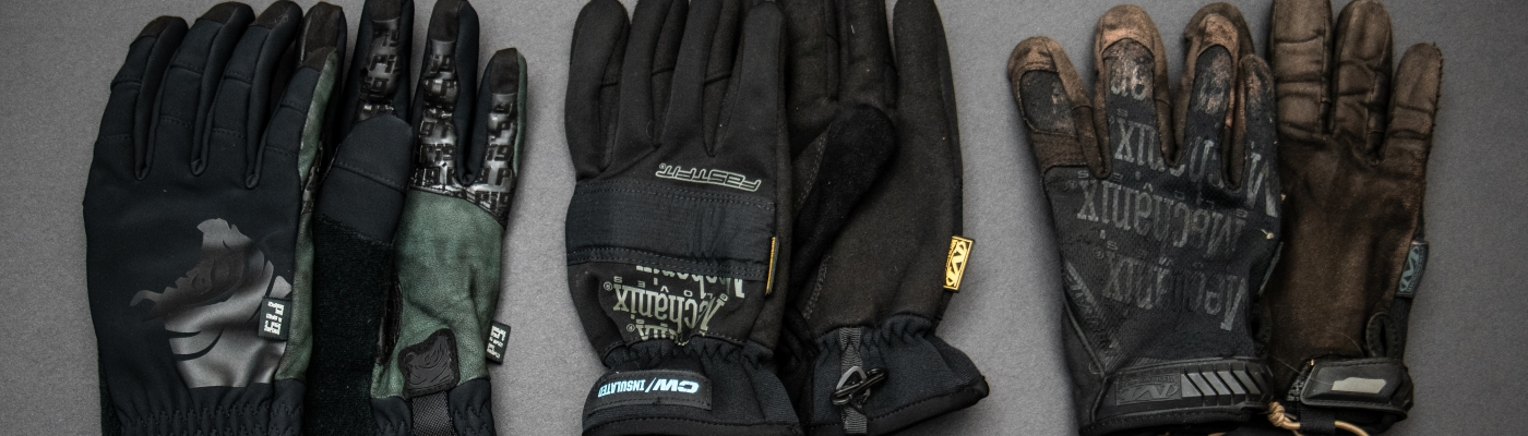 A flat lay of the SKD Insulated gloves and two pairs of mechanix insulated gloves.