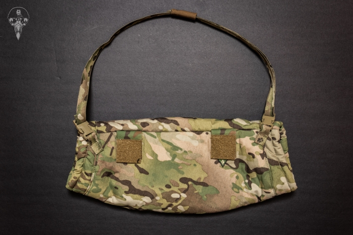 Back side of the c2r handwarmer showing the waist strap and velcro attachment points