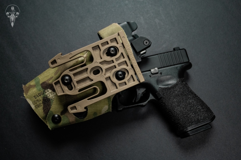 Glock 19 with a Safariland 6354do with OT Defense Nub mod attached