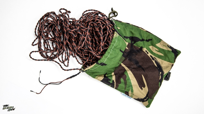 A rope bag full of black and tan firing wire